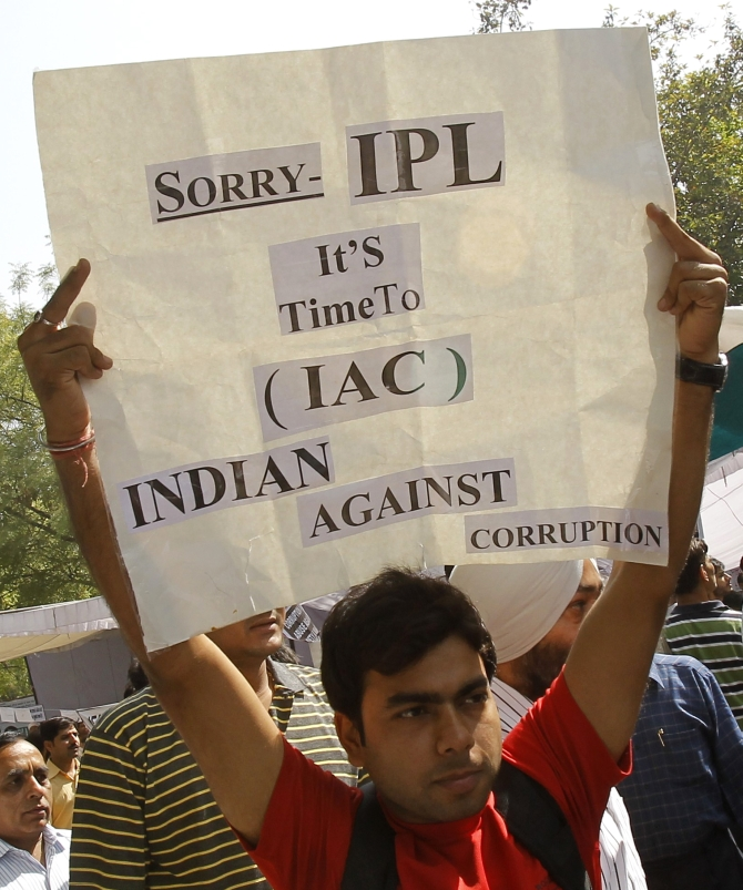 A protester holds a sign during a campaign against corruption in New Delhi