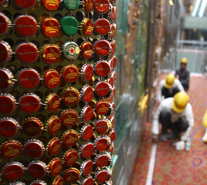 The artwork made of bottle caps. Beyond that is the Mumbai Google Map, made of recycled materials.
