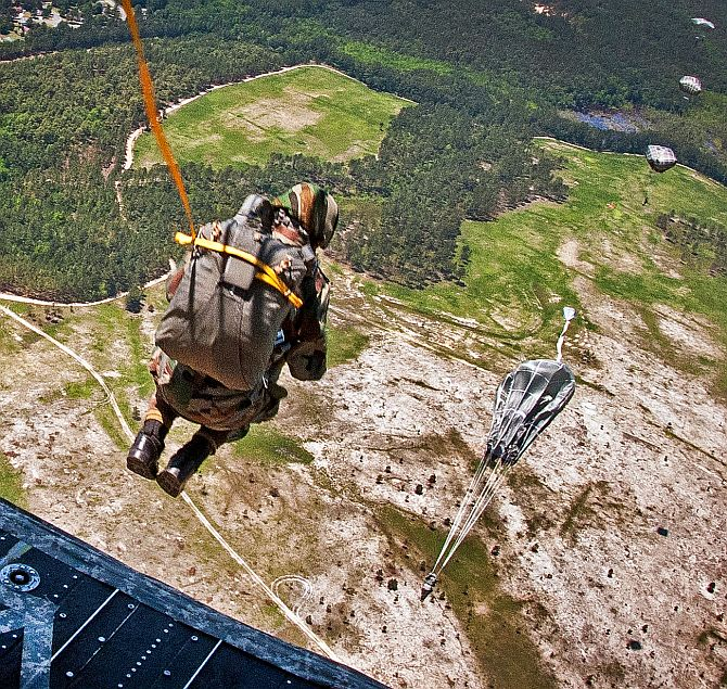 An Indian paratrooper exits a CH-47 Chinook helicopter during the 2013 Yudh Abhyas bilateral training exercise at Fort Bragg, USA.