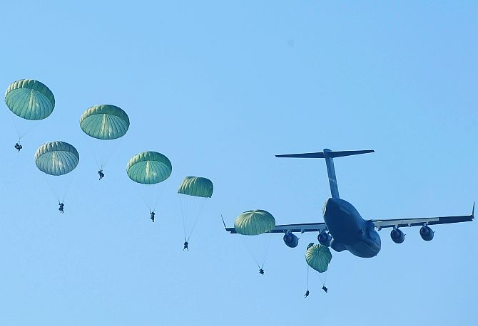 India Army paratroopers parachute from a C-17 Globemaster.