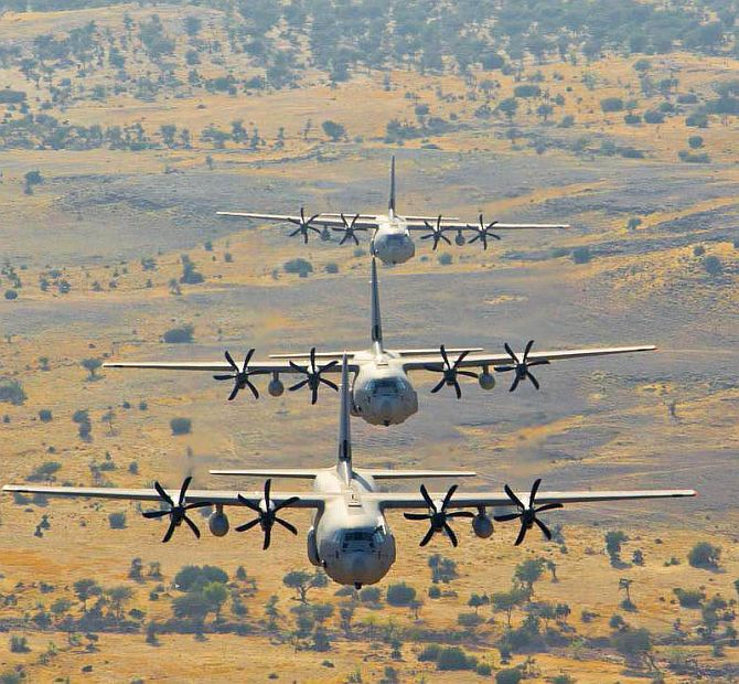 A Hercules C-130J aircraft practices low-level tactical formation over the deserts of Rajasthan.