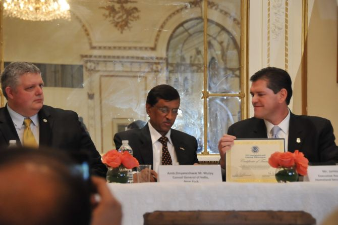 Shawn Bray, director, Interpol, Washington, left, looks on as Ambassador Dnyaneshwar M Mulay, India's consul general in New York, centre, accepts the certificate of transfer from James Dinkins, executive associate director of the Immigration and Customs Enforcement's Homeland Security Investigations.