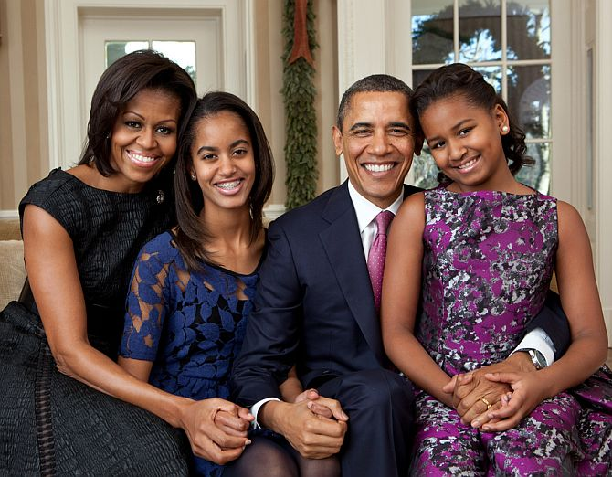 Barack Obama with his family - wife Malia and Natasha