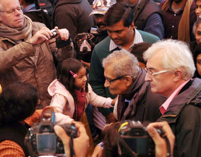 Nobel Laureate Amartya Sen is greeted by a child at the Jaipur Literature Festival