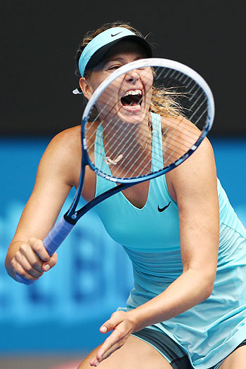 Maria Sharapova of Russia plays a forehand in her third round match against Alize Cornet of France at the Australian Open on Saturday