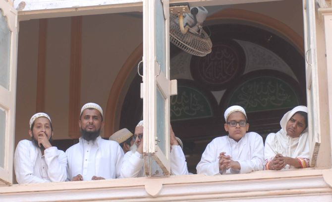 Members of the Bohra Muslim community morn the demise of their spiritual leader Syedna Burhanuddin, in Mumbai on Saturday