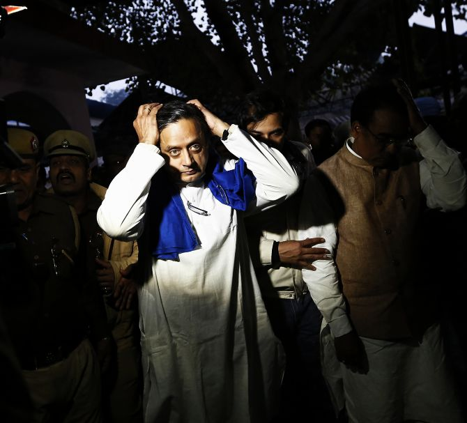 Union Minister Shashi Tharoor gestures after performing the last rites for his wife Sunanda Puskhar at a cremation ground in New Delhi on Saturday.