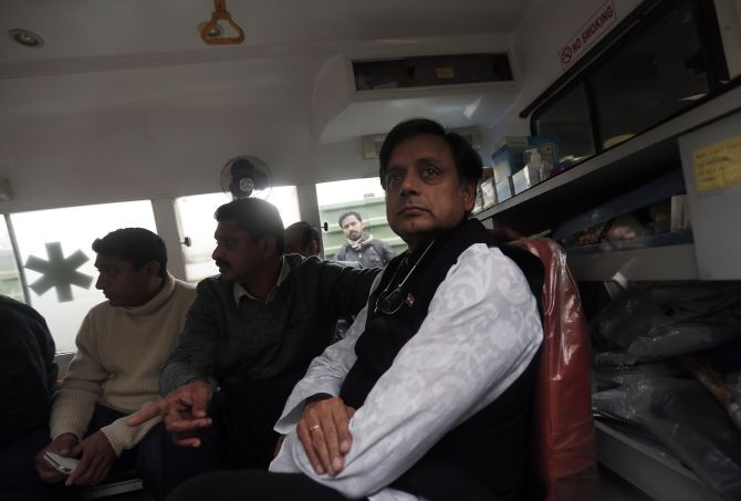 Tharoor sits in an ambulance as he waits outside a mortuary to receive his wife Sunanda Puskhar Tharoor's body at a hospital in New Delhi on Saturday