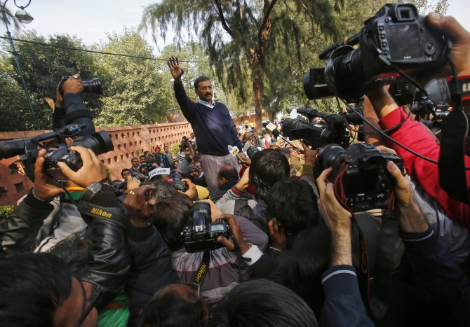 AAP leader Arvind Kejriwal greets supporters during a protest in New Delhi.