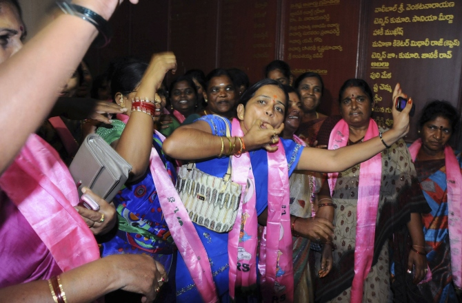 Telangana supporters cheer as they celebrate after the announcement of the separate state of Telangana at their party headquarters in Hyderabad in this photograph taken on July 30, 2013.