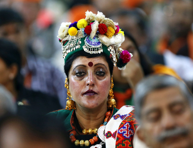 A supporter in traditional attire at a political rally at the Ramlila ground in New Delhi.