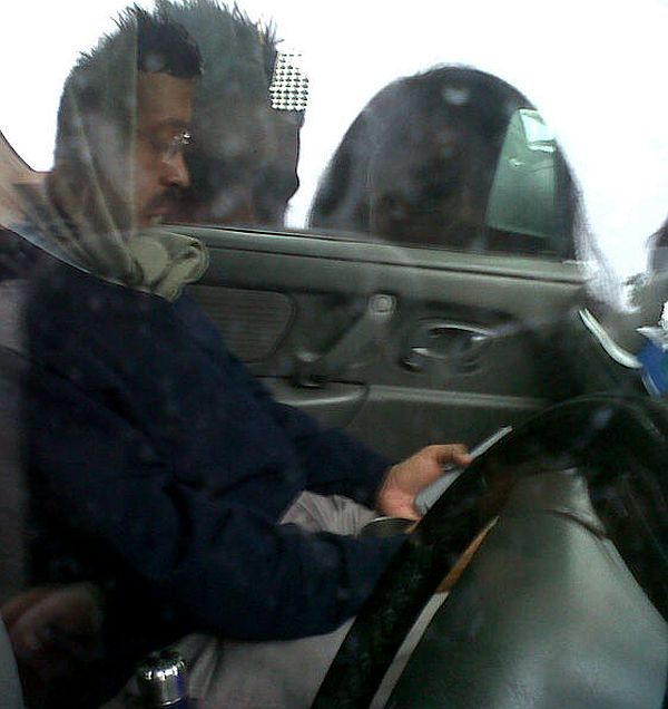 Kejriwal on the phone in his now-famous Maruti Suzuki Wagon R