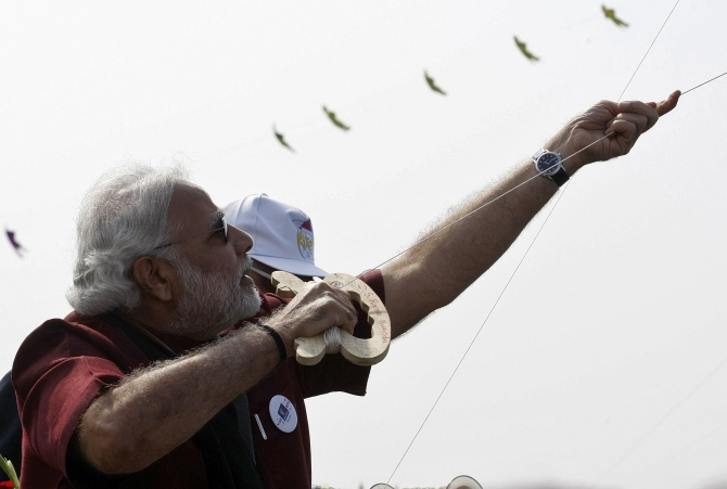 Narendra Modi, prime ministerial candidate for India's main opposition Bharatiya Janata Party and Gujarat's chief minister, flies a kite at the international kite festival in Ahmedabad.