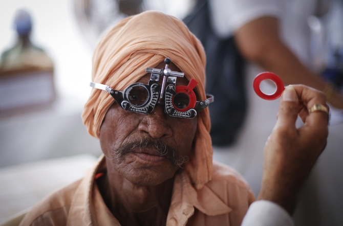 A man gets his eye tested at a free eye-care camp in Mumbai.