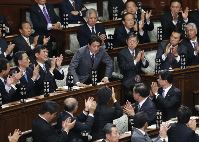 Shinzo Abe is applauded by his party members after being elected as Japan's prime minister at the lower house of the parliament in Tokyo in this photograph taken on December 26, 2012.