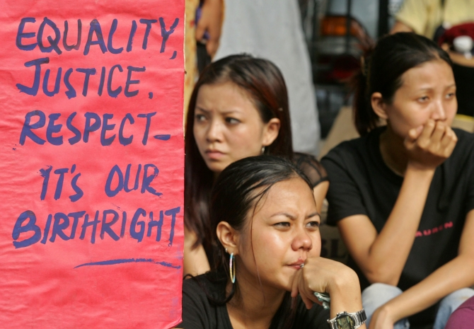 Students from North East Students Joint Action Committee hold a placard during a protest in New Delhi