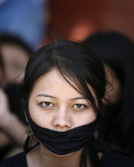 A student from northeast India attends a protest in New Delhi