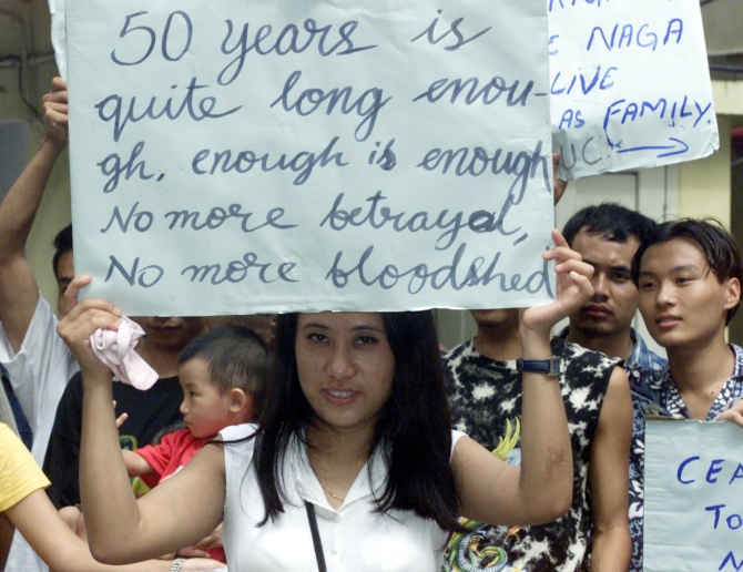 An activist of Naga Student Association holds a poster during a demonstration in Calcutta.