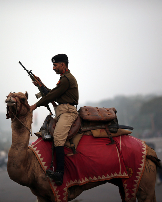 A Border Security Force soldier rides his camel during a rehearsal for the 'Beating the Retreat' ceremony'