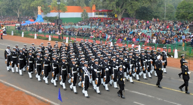The Coast Guard marching contingent passes through Rajpath