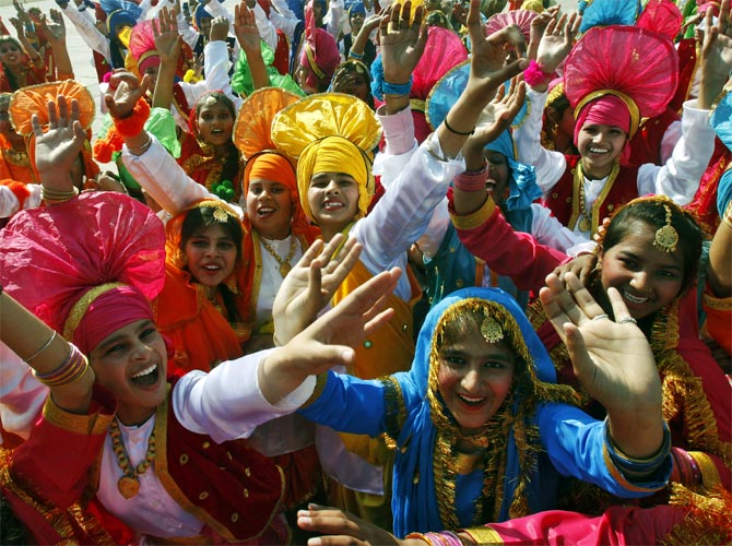 Students cheer after performing a cultural programme during the Republic Day celebration in Chandigarh.