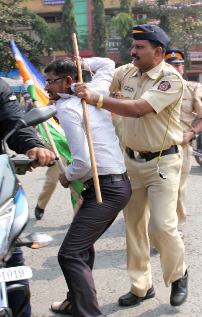 Sahil Salvi captures the image of an MNS activist picked up by the police for allege vandalism at toll booths.