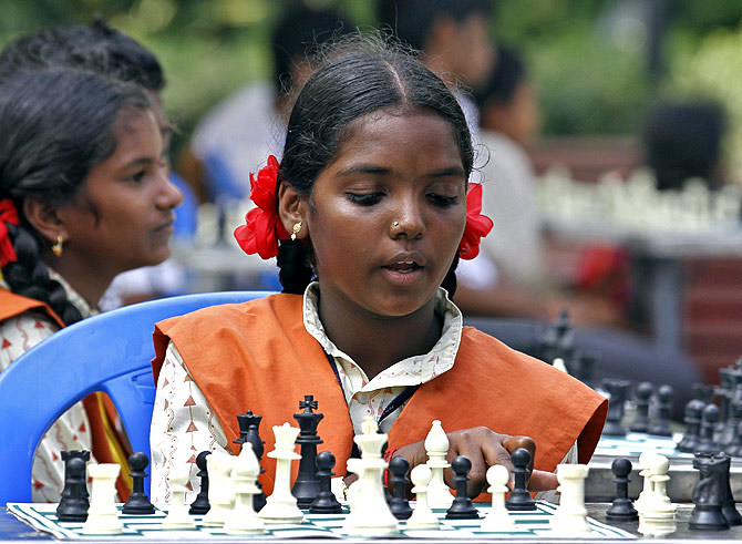 A schoolgirl plays chess in a park in Chennai. Photograph used for representational purposes only.