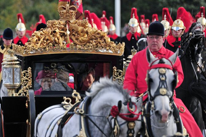 Queen Elizabeth II arrives at Buckingham Palace in her royal carriage