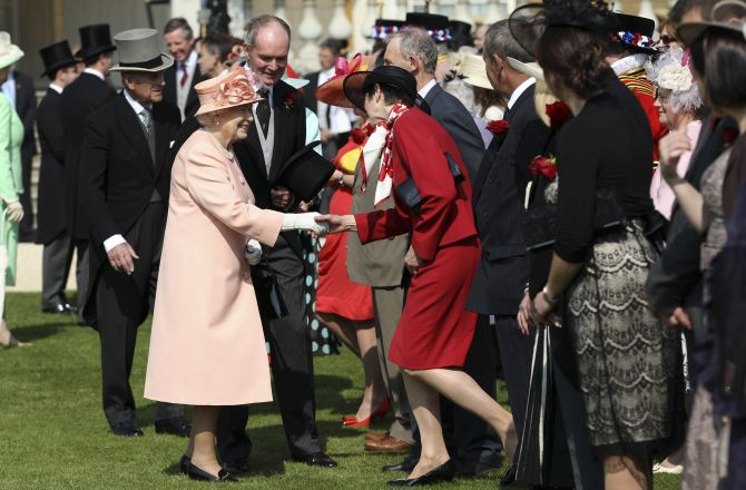 Queen Elizabeth receiving guests at the Buckingham Palace lawns