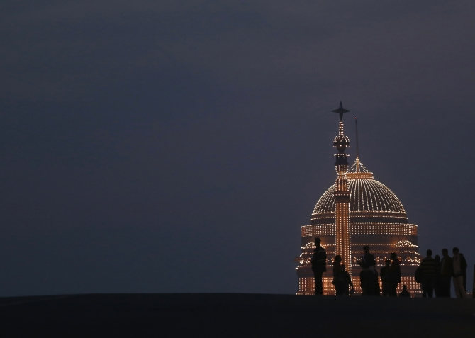 'Beating the Retreat' ceremony in New Delhi  People are silhouetted against the illuminated Rashtrapati Bhavan during the