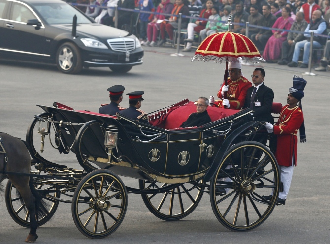 President Pranab Mukherjee arrives in a ceremonial buggy for the Beating the Retreat ceremony in New Delhi
