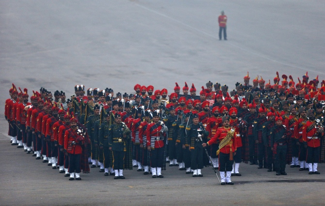 Bands of the Indian military stand to attention during the 'Beating the Retreat' ceremony in New Delhi.
