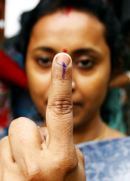 A voter shows the indelible ink mark on her finger after casting her ballot at a polling booth in Siliguri during the 2009 Lok Sabha elections.