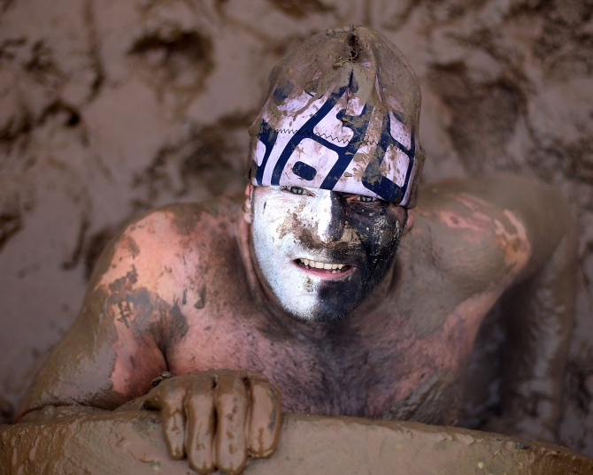 A participant pulls himself from a tunnel during the Tough Guy Challenge in Telford, England.