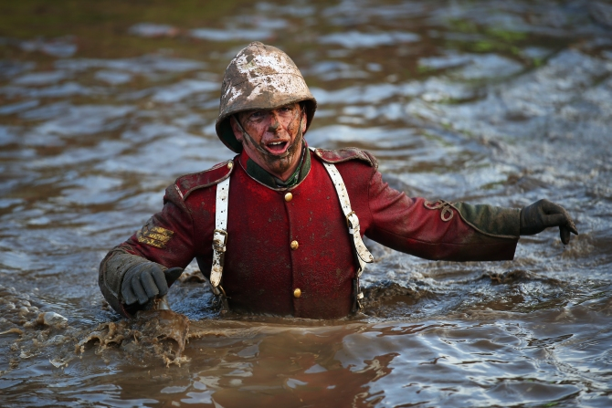 A competitor wades through water during the Tough Guy Challenge in Telford, England.