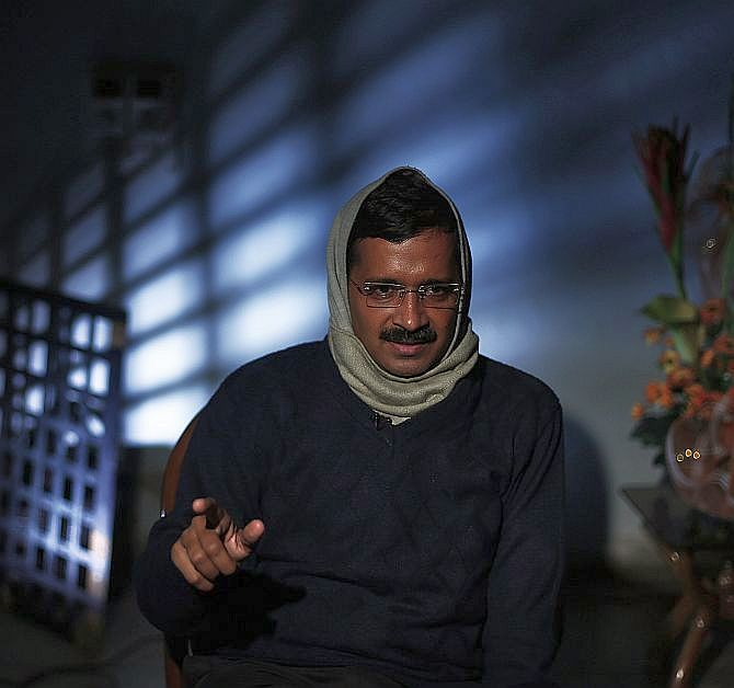 Delhi's Chief Minister Arvind Kejriwal speaks during an interview with Reuters at his residence