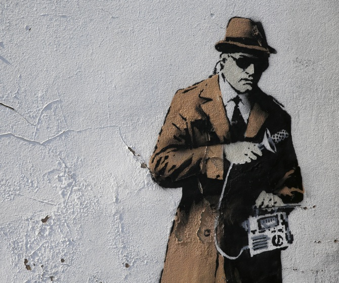 A detail from graffiti art is seen on a wall near the headquarters of Britain's eavesdropping agency, Government Communications Headquarters, known as GCHQ, in Cheltenham, western England