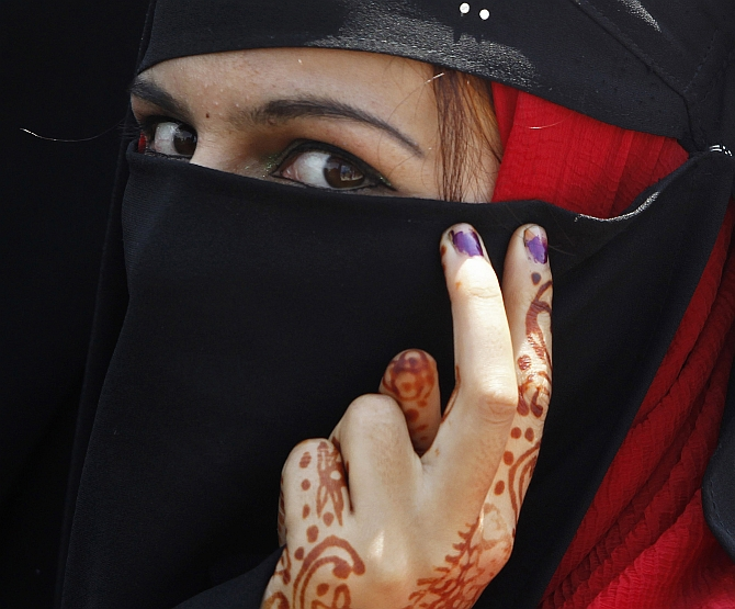 A member a Kashmiri women's separatist group attends a protest in Srinagar