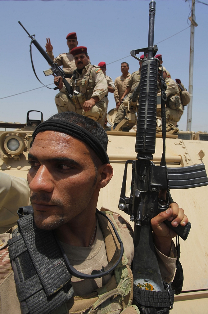 An Iraqi Soldier prepares during an intensive security deployment in Iraq