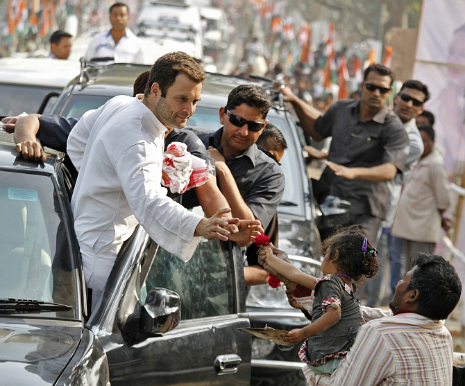 Congress Vice President Rahul Gandhi during a road show in Assam's Samuguri village