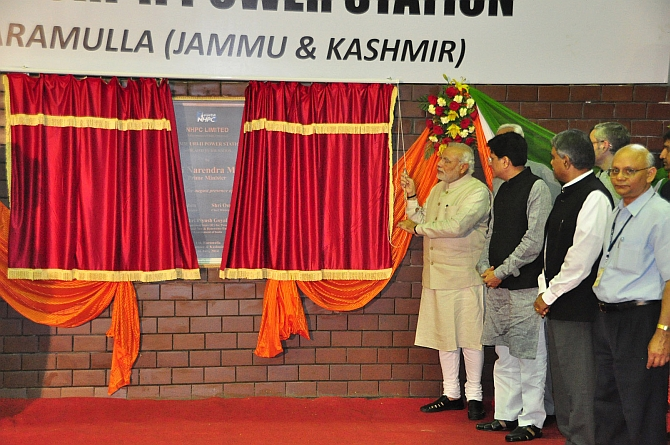 Modi inaugurates the hydro electric project along with Union minister Piyush Goyal and Governor N N Vohra