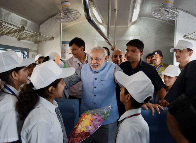 PM Narendra Modi aboard the new Katra train along with school children
