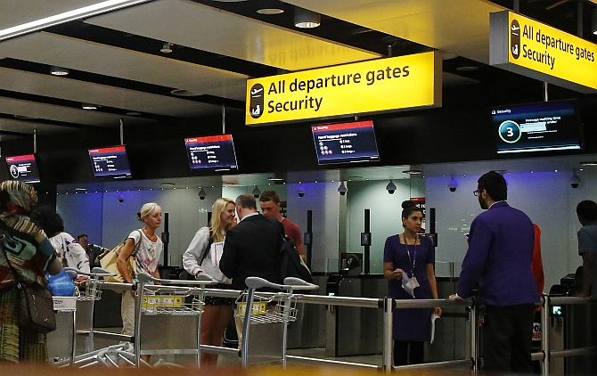 Passengers head towards security control at Heathrow airport in London. Britain has stepped up security at airports after US officials said they were concerned that Al Qaeda operatives were developing bombs that could be smuggled onto planes.