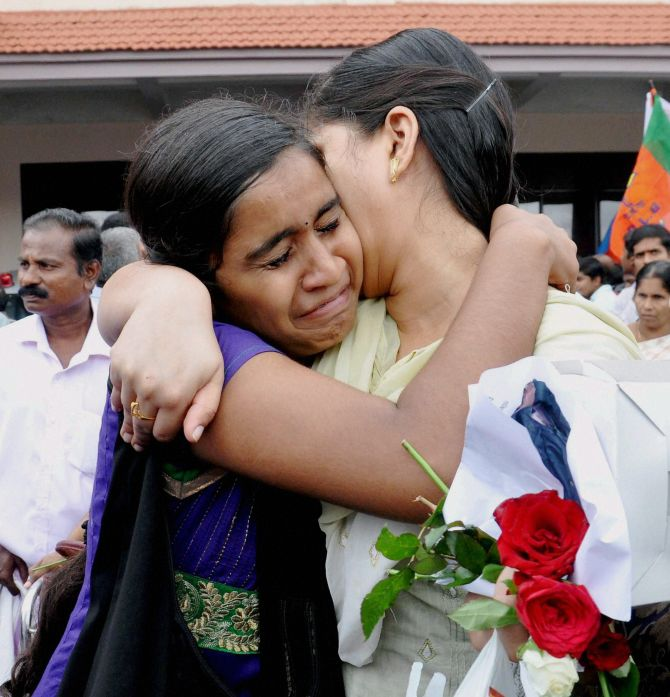 One of the nurses who was stranded in the territory held by Islamic extremists in Iraq, hugs her relative upon arrival at the airport in Kochi on Saturday.