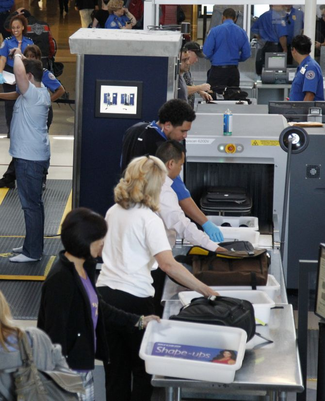Travellers go through a TSA security checkpoint at LAX airport in Los Angeles
