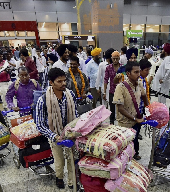 Indian workers rescued from Iraq arrive at the Delhi airport