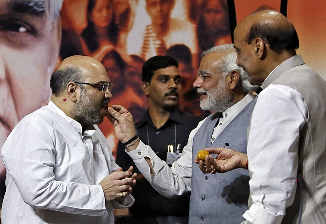 PM Narendra Modi and Home Minister Rajnath Singh offer sweets to Shah