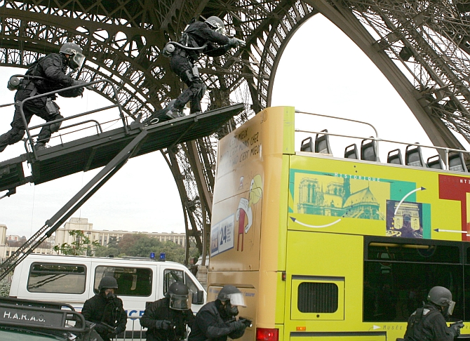 French special police force RAID ( Research, assistance, intervention and deterrence) conduct a mock-intervention on a double-deck tourist bus during an training exercise near the Eiffel Tower in Paris