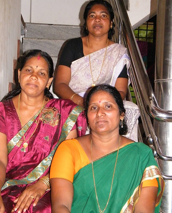 Bindu (in a green sari) with her friends Sheeba and Sreeja.