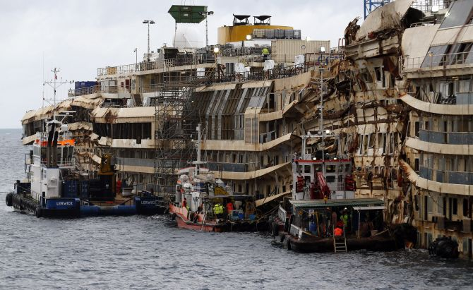 The half-risen Costa Concordia which has been in the water for the last two-and-a-half years.